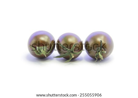 Black tomato group with green stick on white background