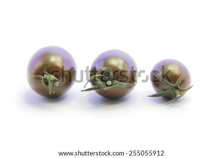 Black tomato size with green stick on white background
