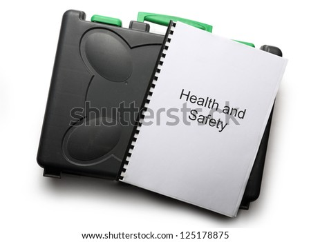 Black toolbox and notebook on white background