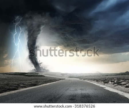 Black tornado funnel and lightning on road - stock photo