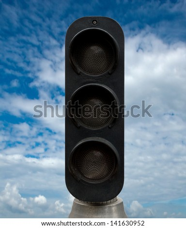 Black traffic lights against blue sky backgrounds. Clipping Path included. - stock photo