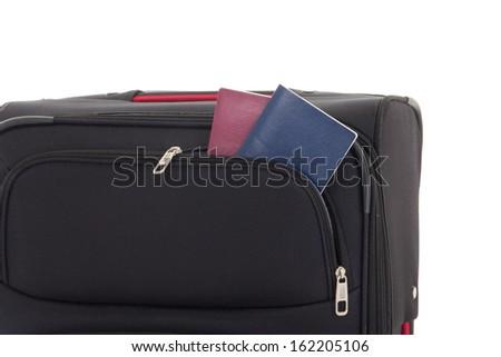 black travel suitcase and passports isolated on white background - stock photo