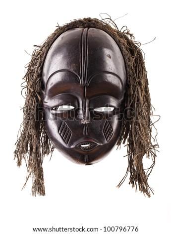 Black tribal face mask on isolated on white - stock photo