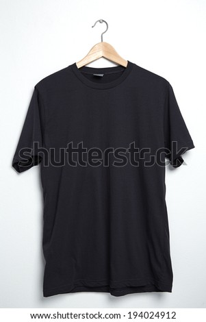 Black tshirt template on hanger ready for your own graphics. - stock photo