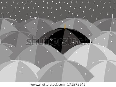 Black umbrella among lighter colour umbrellas - stock photo