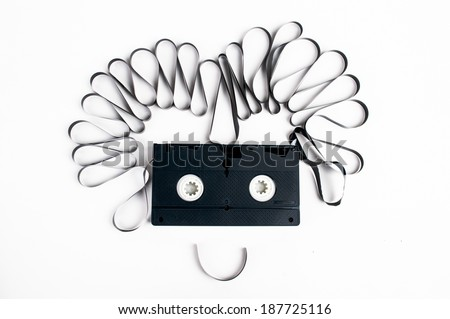 Black VHS Tape Unwound Isolated on White Background.  - stock photo