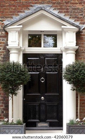 Black Victorian front door - stock photo