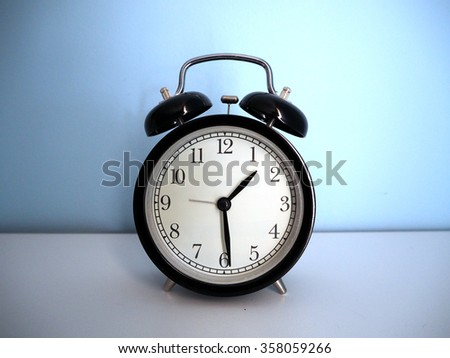 black vintage alarm clock