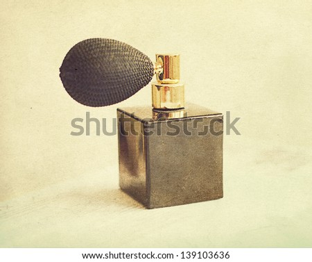 black vintage bottle of perfume, retro - stock photo