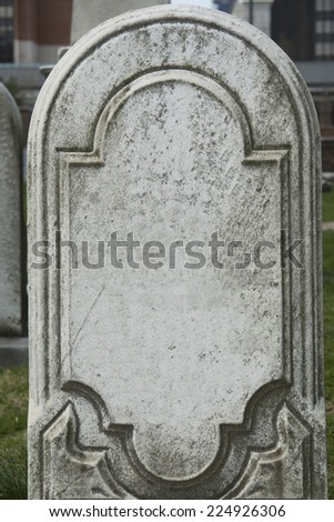 Black vintage eighteenth century tombstone. - stock photo