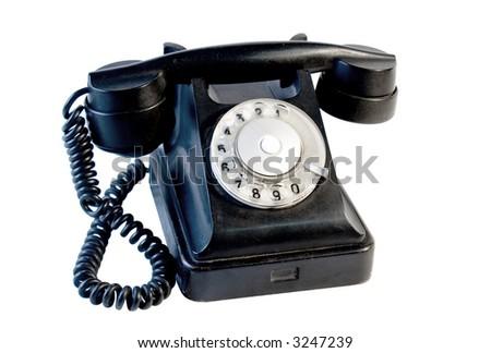 Black vintage phone isolated on white - stock photo