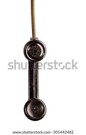 Black vintage phone receiver on white - stock photo