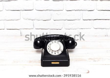 Black vintage telephone - stock photo