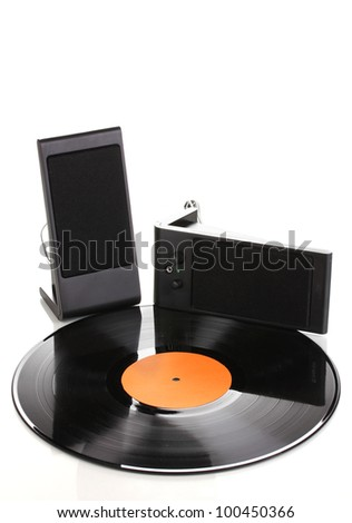 Black vinyl record and loudspeakers isolated on white - stock photo