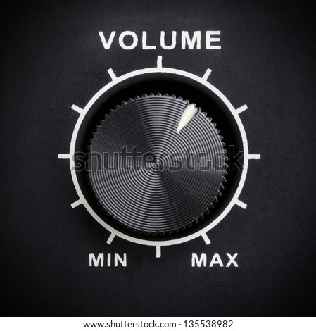 Black volume control knob closeup - stock photo