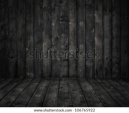 black wall and wooden floor