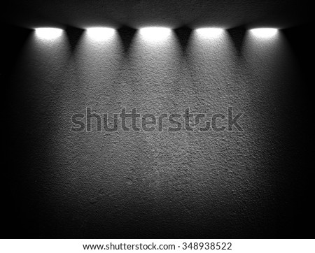 black wall with spotlights - stock photo