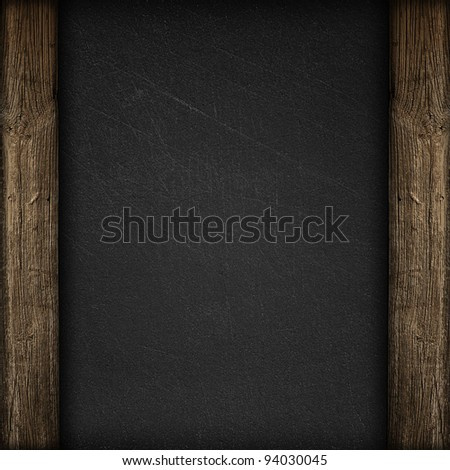 Black wall with wooden panels background or texture - stock photo