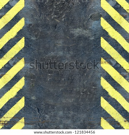 Black wall with yellow paint to draw attention background - stock photo