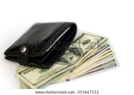 Black wallet with dollars isolated on white. - stock photo