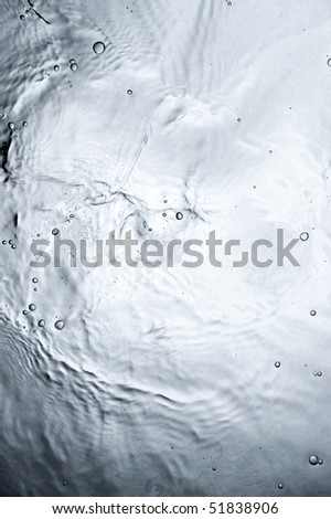 Black water surface with bubbles - stock photo