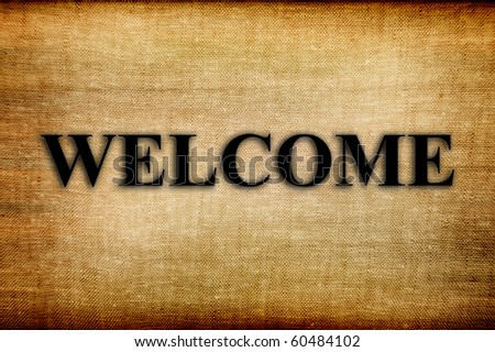 black welcome notice on a brown fabric, Illustration - stock photo