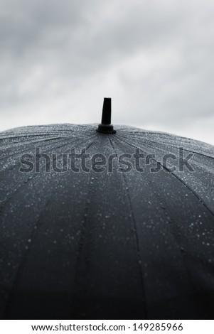 black wet umbrella , selective focus on center of photo - stock photo