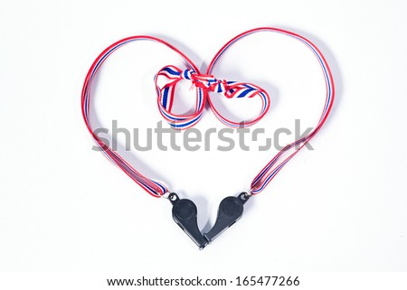 black whistles with Thailand national flag lanyard in heart shape on white background - stock photo