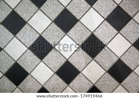 Black white and gray checkered floor tiles - Background image. - stock photo