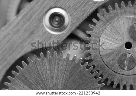 Black white background with metal cogwheels a clockwork. Conceptual photo for your successful business design. Macro - stock photo