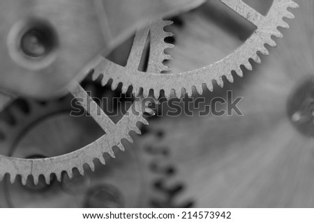 Black white background with metal cogwheels a clockwork.Rather unique macro photo, for your successful business design. Extreme closeup. Macro  - stock photo