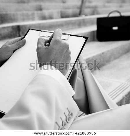 Black-white close-up photo of working outdoor young man. - stock photo