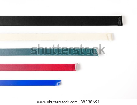 Black; white; green; red; blue tape isolated on white. - stock photo