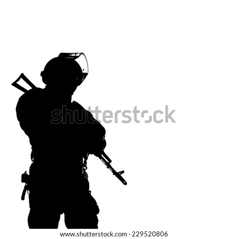 Black white image, silhouette of police officer with weapons - stock photo