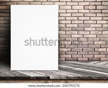 Black White paper poster lean at red brick wall and tropical wood table,Template mock up for adding your text. - stock photo