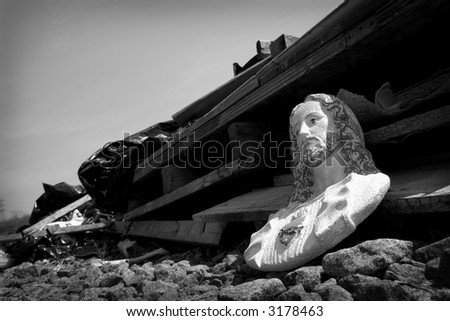 black & white photograph of a discarded Jesus bust - stock photo