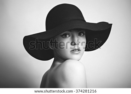 Black white portrait of woman in black hat  - stock photo