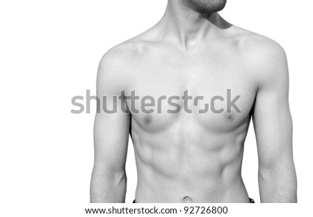 Black & white shot of a male torso isolated on white. - stock photo