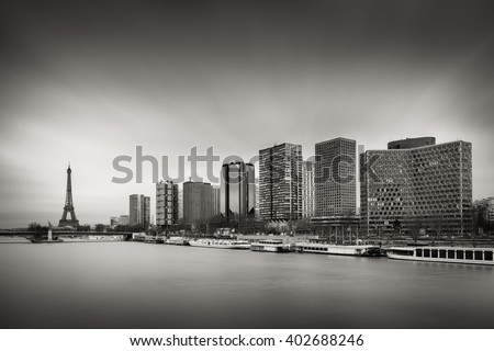Black & White skyline with high-rise Left Bank buildings in the 15th Arrondissement with the Eiffel Tower ,Seine River and Pont de Grenelle, Paris, France - stock photo