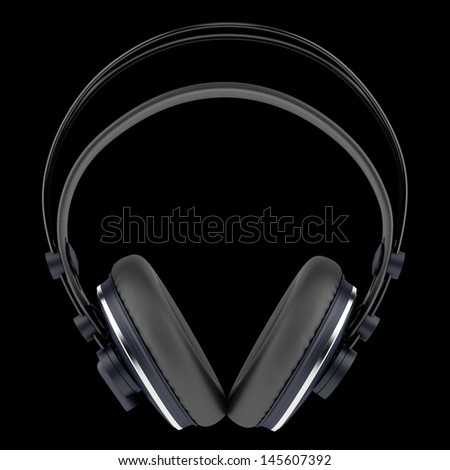 black wireless headphones isolated on black background - stock photo