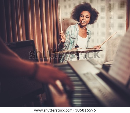 Black woman drummer in a recording studio  - stock photo