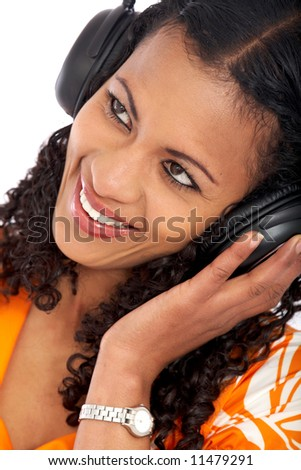 black woman enjoying the music smiling - isolated over a white background - stock photo