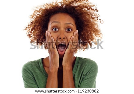 Black woman holding hands to face in surprise, shocked isolated over white - stock photo