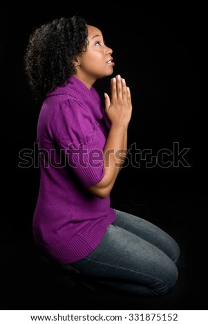 Kneeling In Prayer Stock Photos, Images, & Pictures ...
