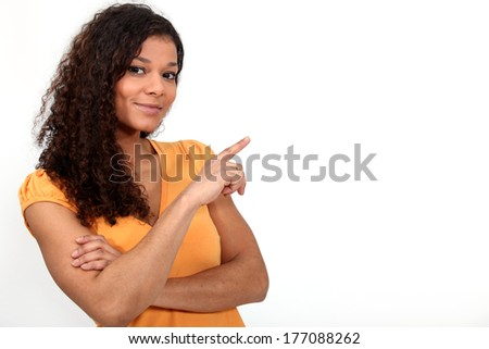 Black woman pointing with her finger. - stock photo