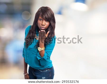 black woman sending a kiss - stock photo