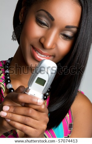 Black woman sending reading text message - stock photo