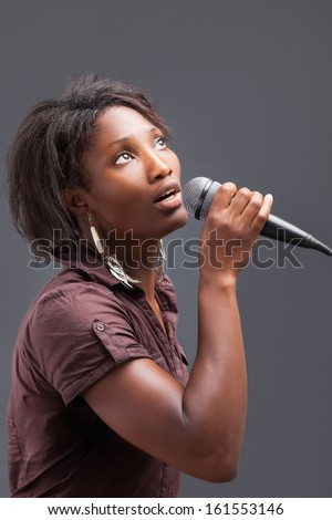 Black Woman Singing Into Microphone - stock photo