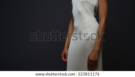 Black woman standing in an elegant gown