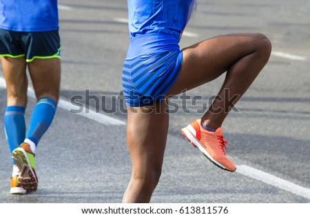 black woman warming up before a race